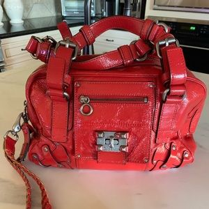 Juicy Couture Bags - Juicy Couture patent red leather clutch handbag
